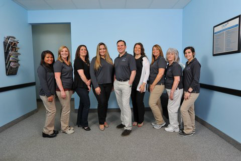 Group photo of the staff at Calm Dental P.C.